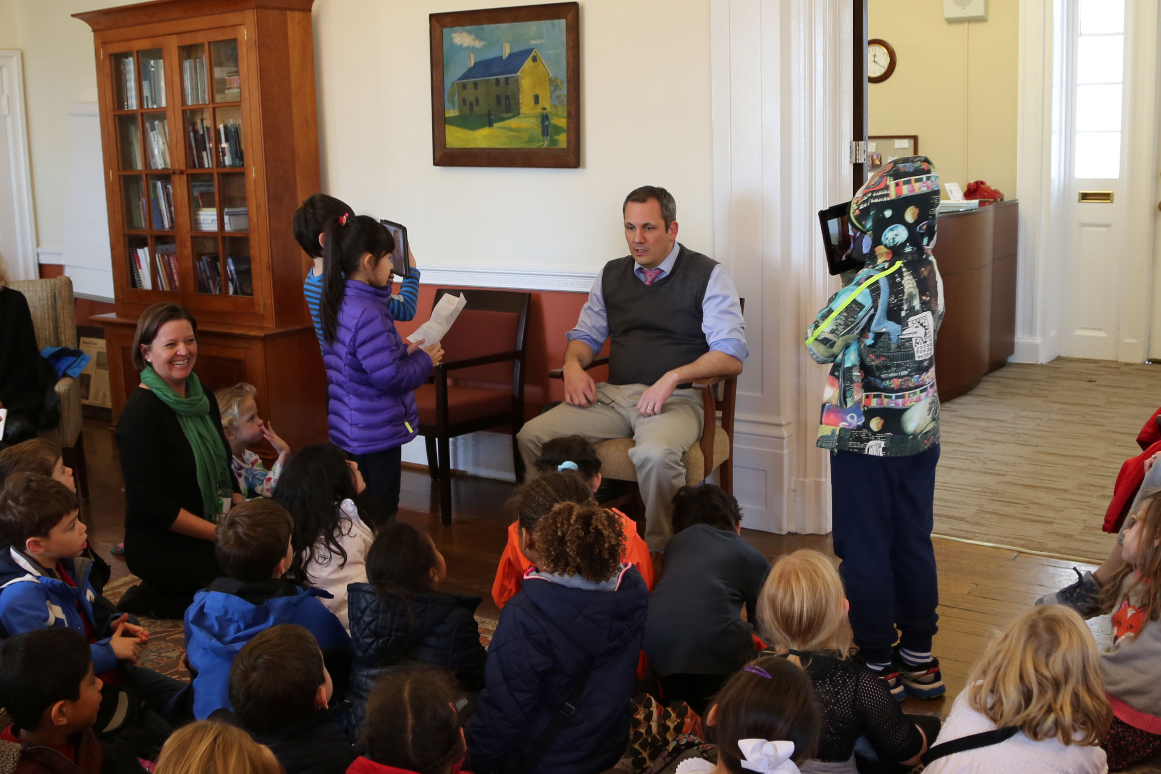 First graders interview Head of School Bryan Garman as part of their study of community